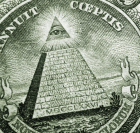 close-up of the eye & pyramid on US dollar